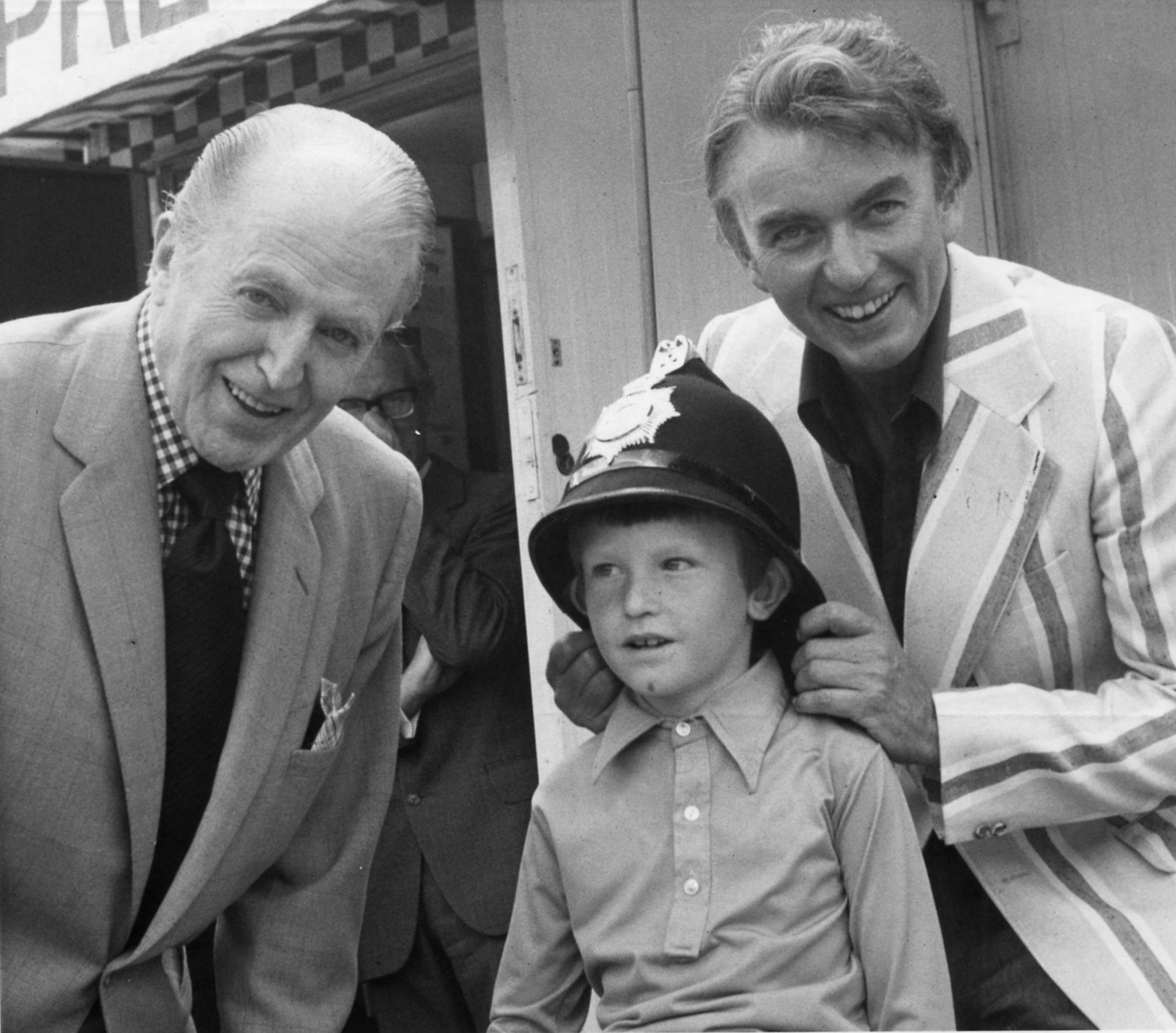 Peter and Jack Warner with Ferndown fan Simon Bright at a crime prevention exhibition in 1975