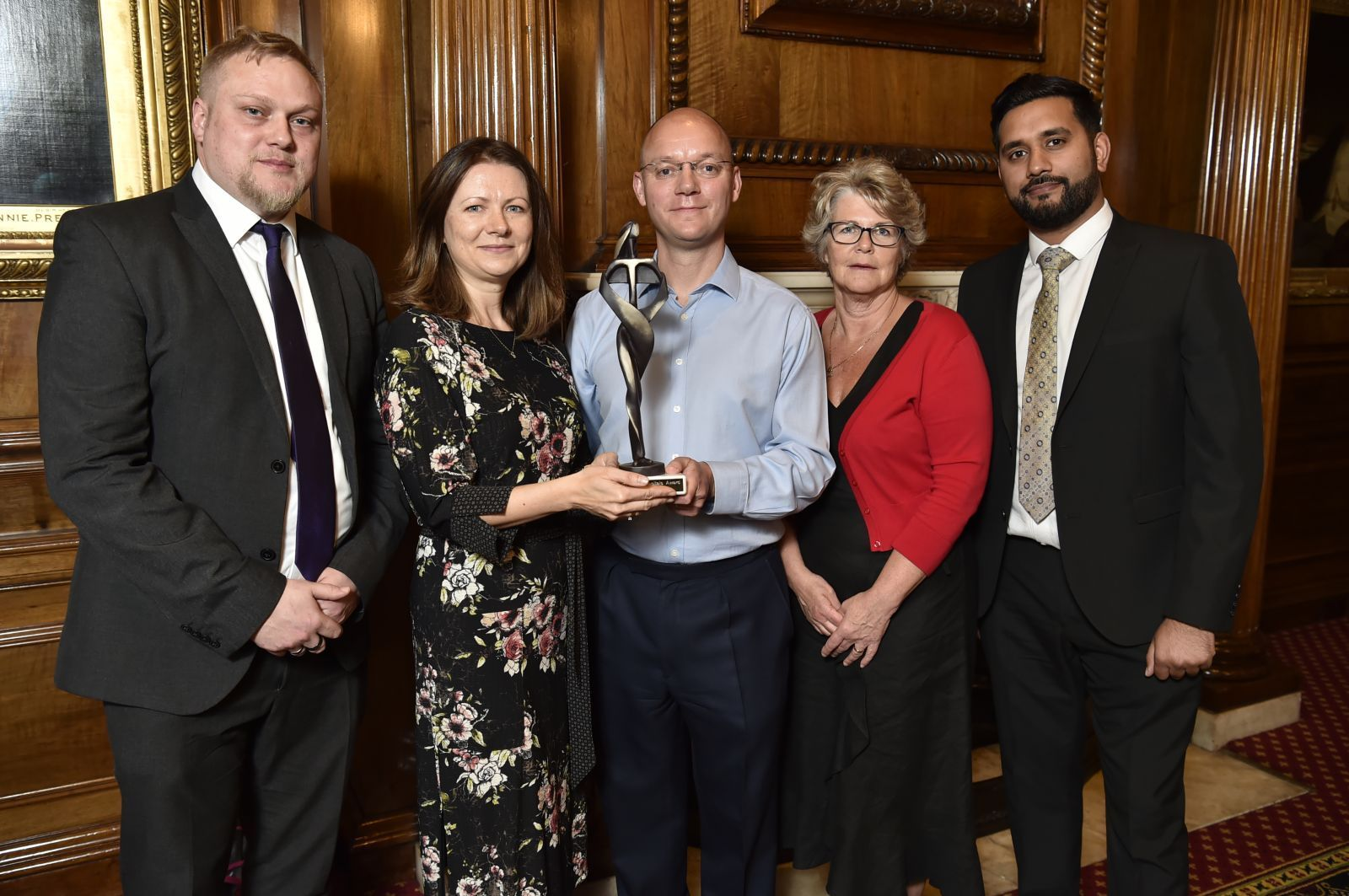RECOGNITION: Receiving the award on behalf of Dorset County Hospital NHS Foundation Trust are, from left, estates programme manager Anthony Brewis, diabetes nurse specialist Agnes Graja, senior midwife Linda Deadman and head of workforce resourcing Ikram