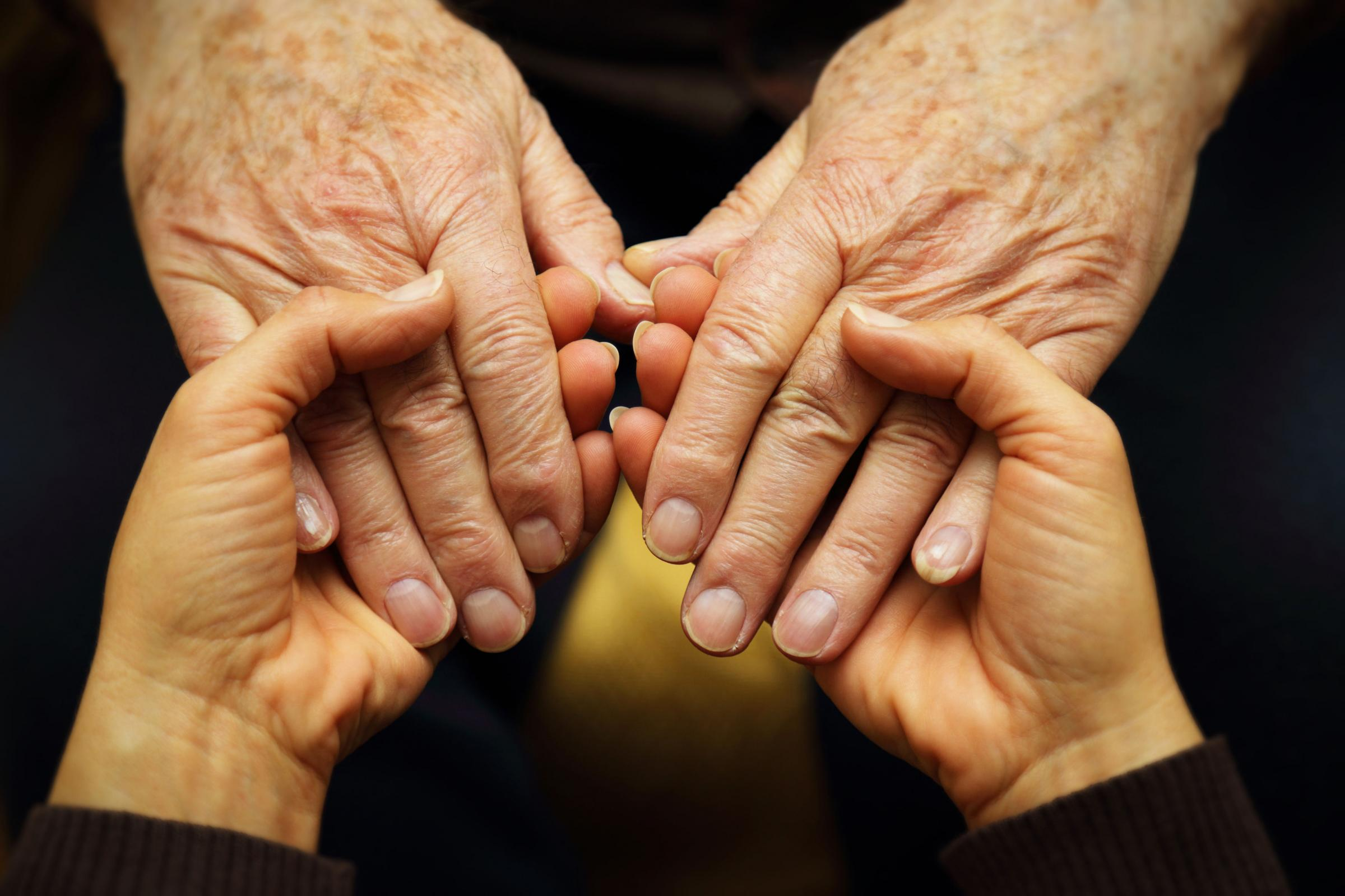 A Generic Photo of an adult holding the hands of an elderly adult. See PA Feature TOPICAL Parental Care. Picture credit should read: PA Photo/thinkstockphotos. WARNING: This picture must only be used to accompany PA Feature TOPICAL Parental Care...