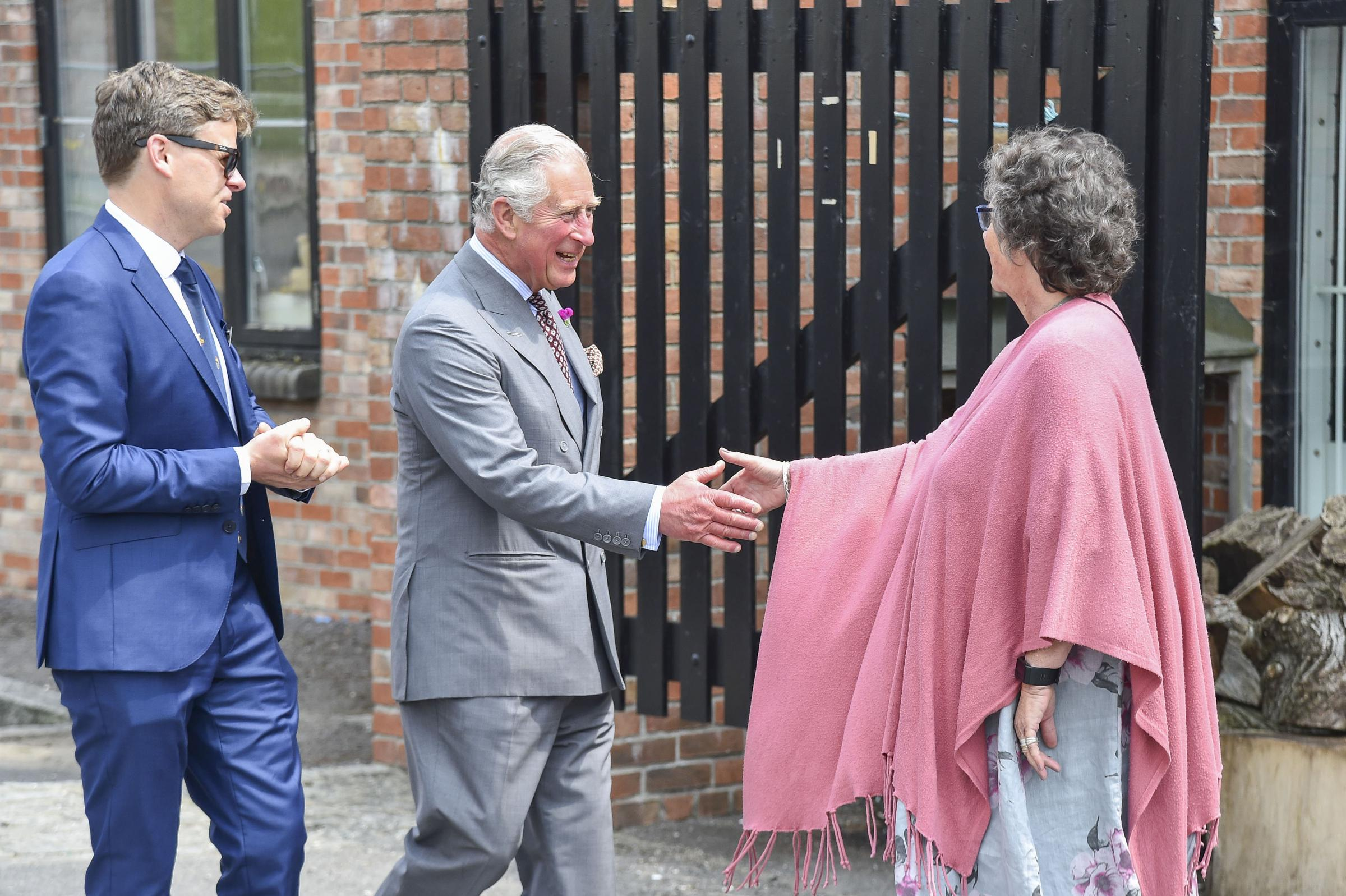 The Prince of Wales is greeted by Sarah Drew, director of the Dorset Centre for Creative Arts PICTURE: Graham Hunt