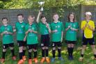 SOARING: Maiden Newton Harriers soar high as they lift the under-11s cup