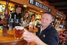 RAISE A GLASS: Rhos Thompson and team at the Wyke Smugglers