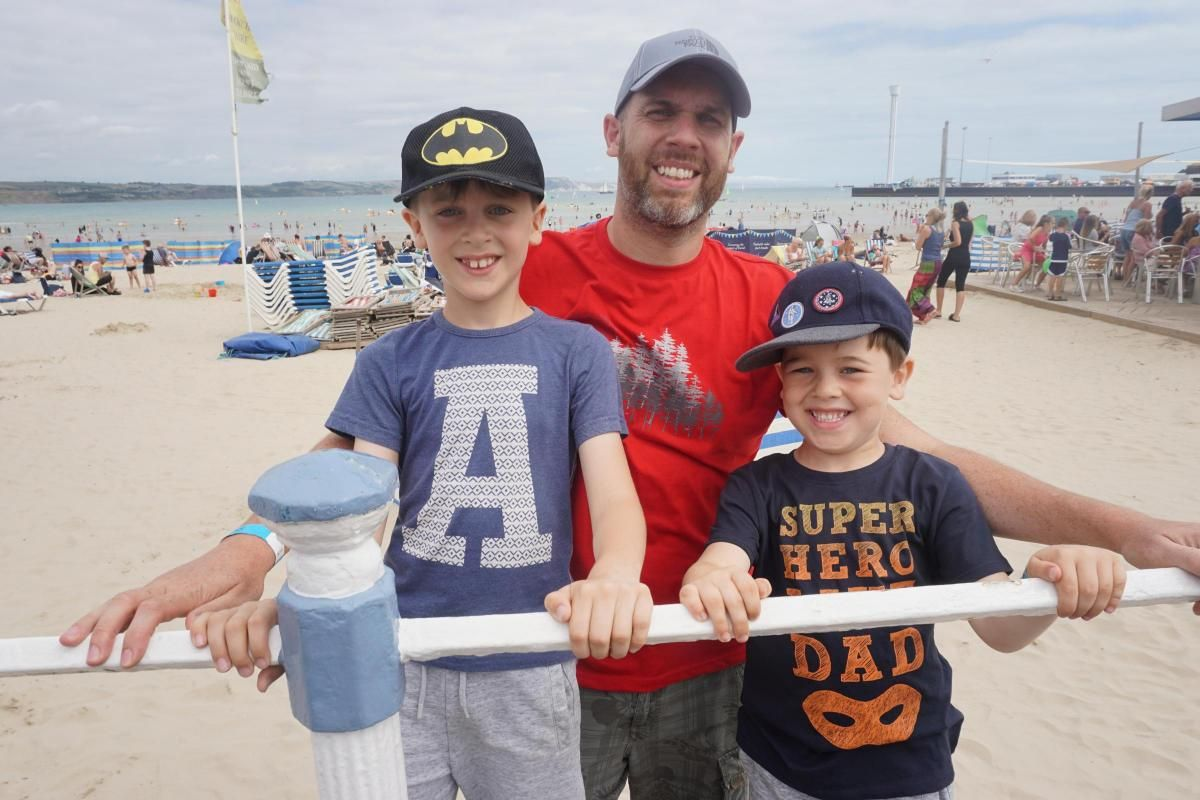 FUN: Zachary and Leo Olden with their dad Chris at Weymouth Beach