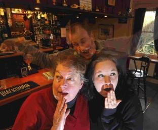 Landlady Pat Hawkins, left, of the Five Bells, Whitchurch Canonicorum, and Kizzy Brown from Dorset Wildlife Trust get a scare