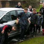 members of the Crossways youth forum wash their first car of the morning