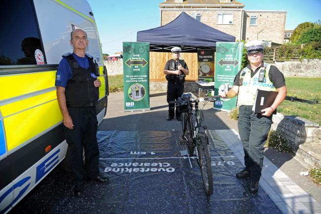 No Excuse team raise awareness of overtaking clearance for cyclists in Weymouth, Heidi Moxam (Road Casualty Reduction Officer for Dorset), right, with PCSO Mark Benwell, left and PC James Leonard, display the distance needed to overtake a cyclist. Picture