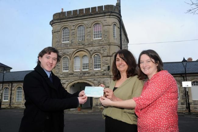 ONGRATULATIONS: Reporter Sam Beamish hands over the cheque to Juliet Ruddick and Mary Randall Picture: Finnbarr Webster