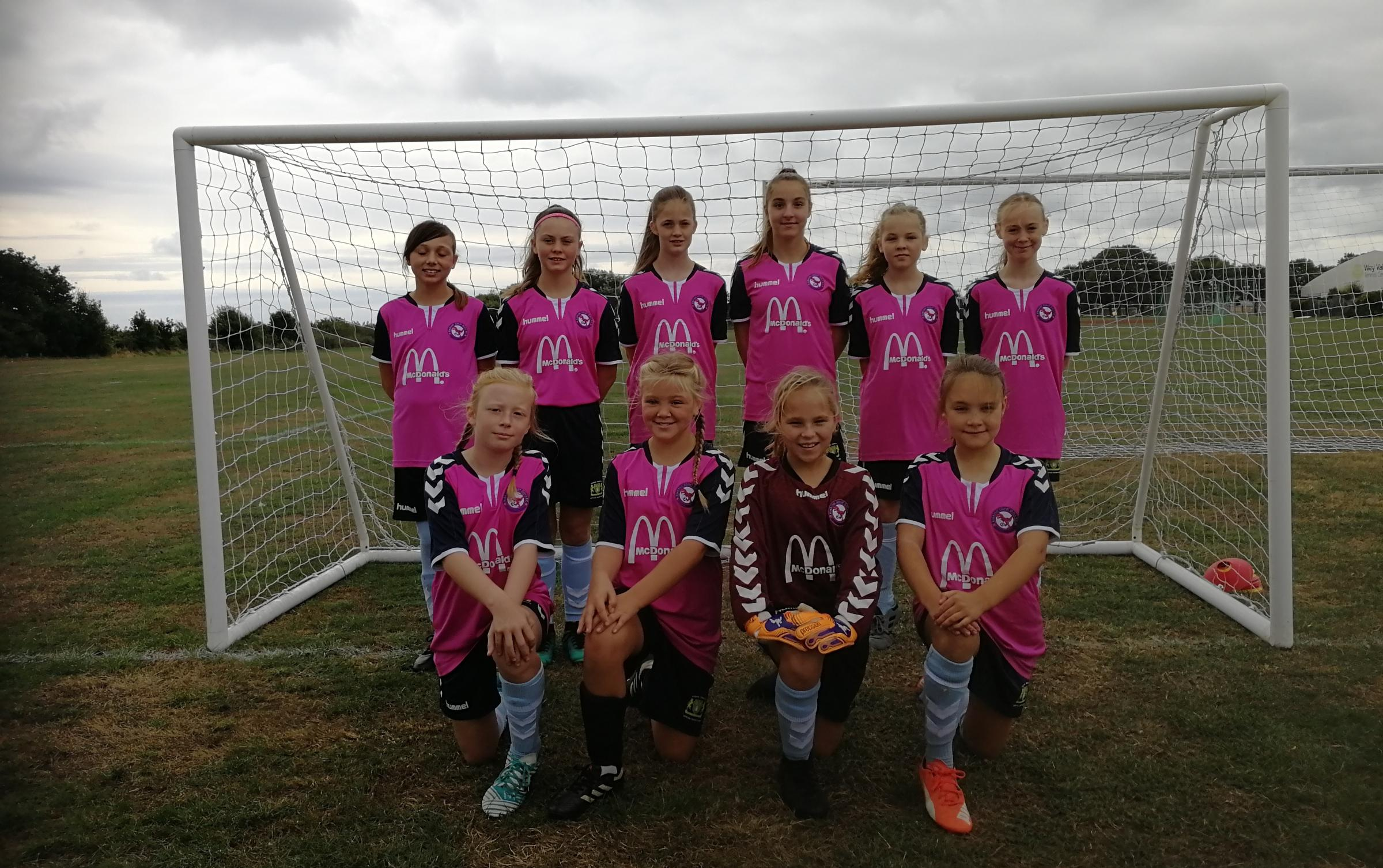 NEW KIT: Jurassic Coast Girls under-12s in their kit sponsored by McDonalds drive through Weymouth