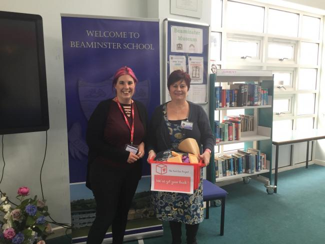 DONATION: Cerri Killworth, a volunteer for The Red Box Project, passing on a red donations box to Helen Pinkett at Beaminster School