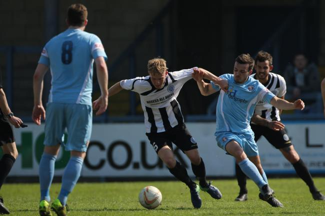 TIME UP: Ollie Griggs, centre, has left Dorchester Town with immediate effect