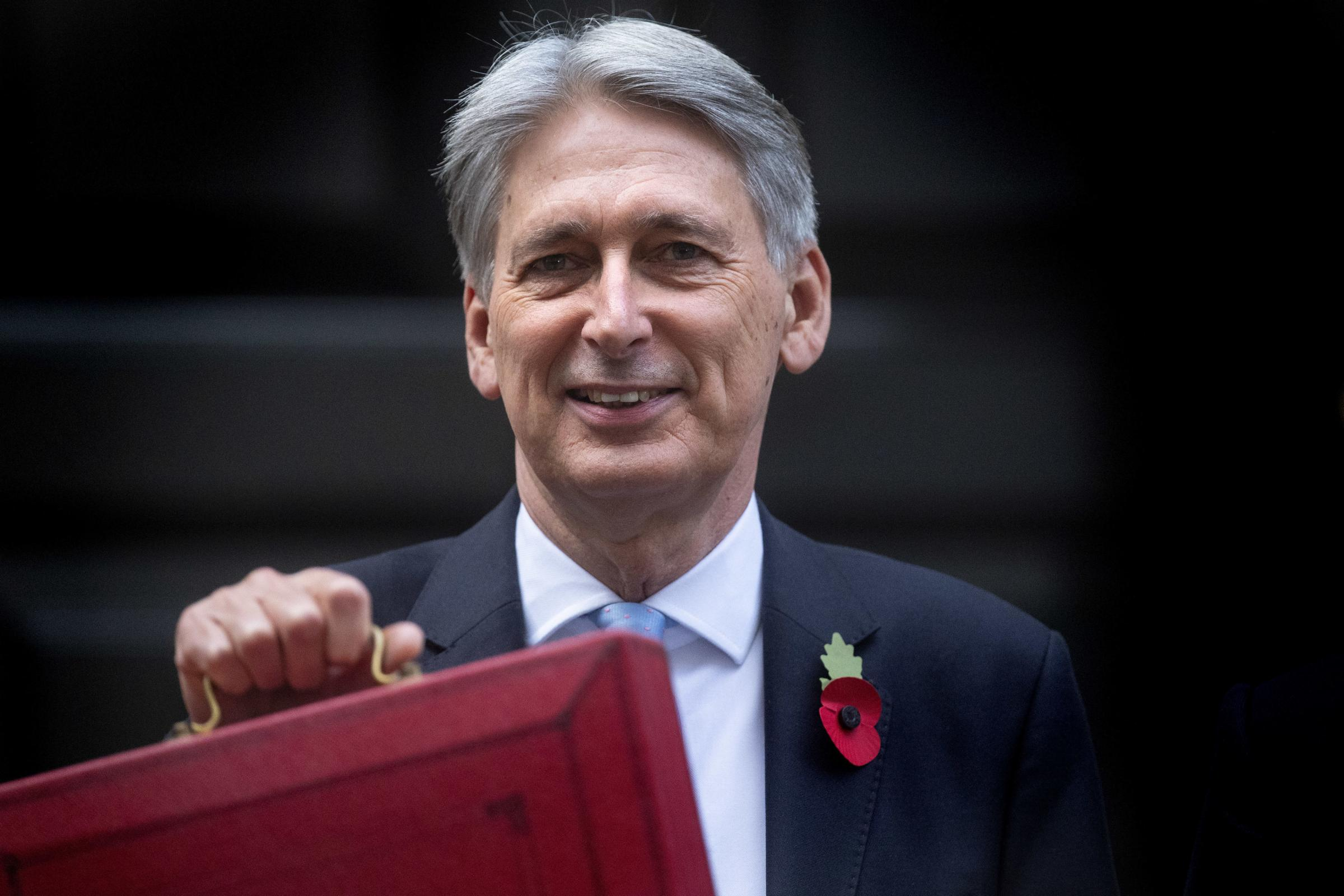 CUTS: Chancellor Philip Hammond outside 11 Downing Street Picture: PA Wire