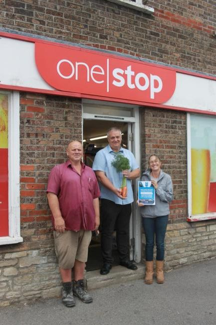•	Volunteers and Chris  Sam (allotment manager) plus One Stop manager Chris Taylor