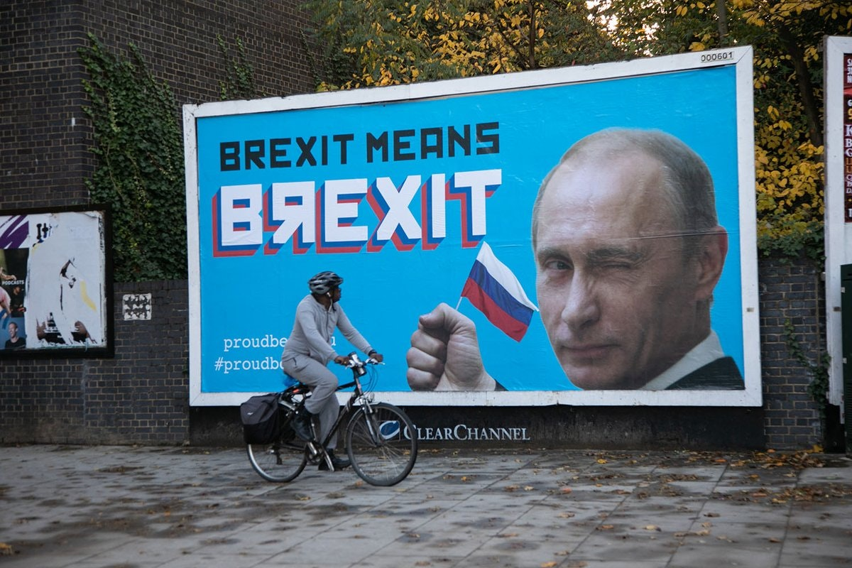 'Brexit means Brexit': Pranksters place Putin billboards across London