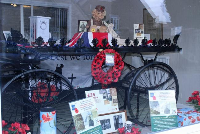 a rbl display at grassby funeral service is commemorating the wwi centenary