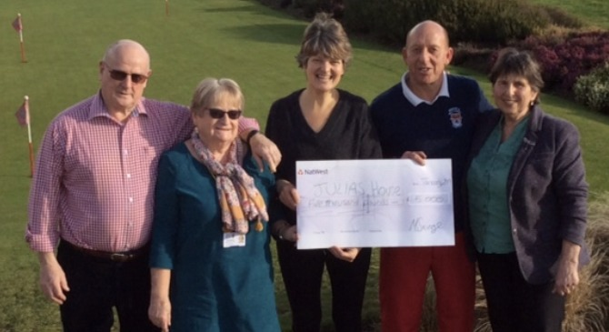 GOOD CAUSE: Mike Savage, club captain and Jackie Savage plus lady captain Sally Woolmington handed a cheque over to Julia's House