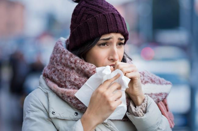 A new and continuous cough is a common symptom of Covid-19 (Shutterstock)