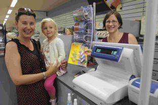 TILL WE MEEET AGAIN: Wellworths' 100,000th customer Heather Ikin and her daughter Hannah with store manager Claire Robertson