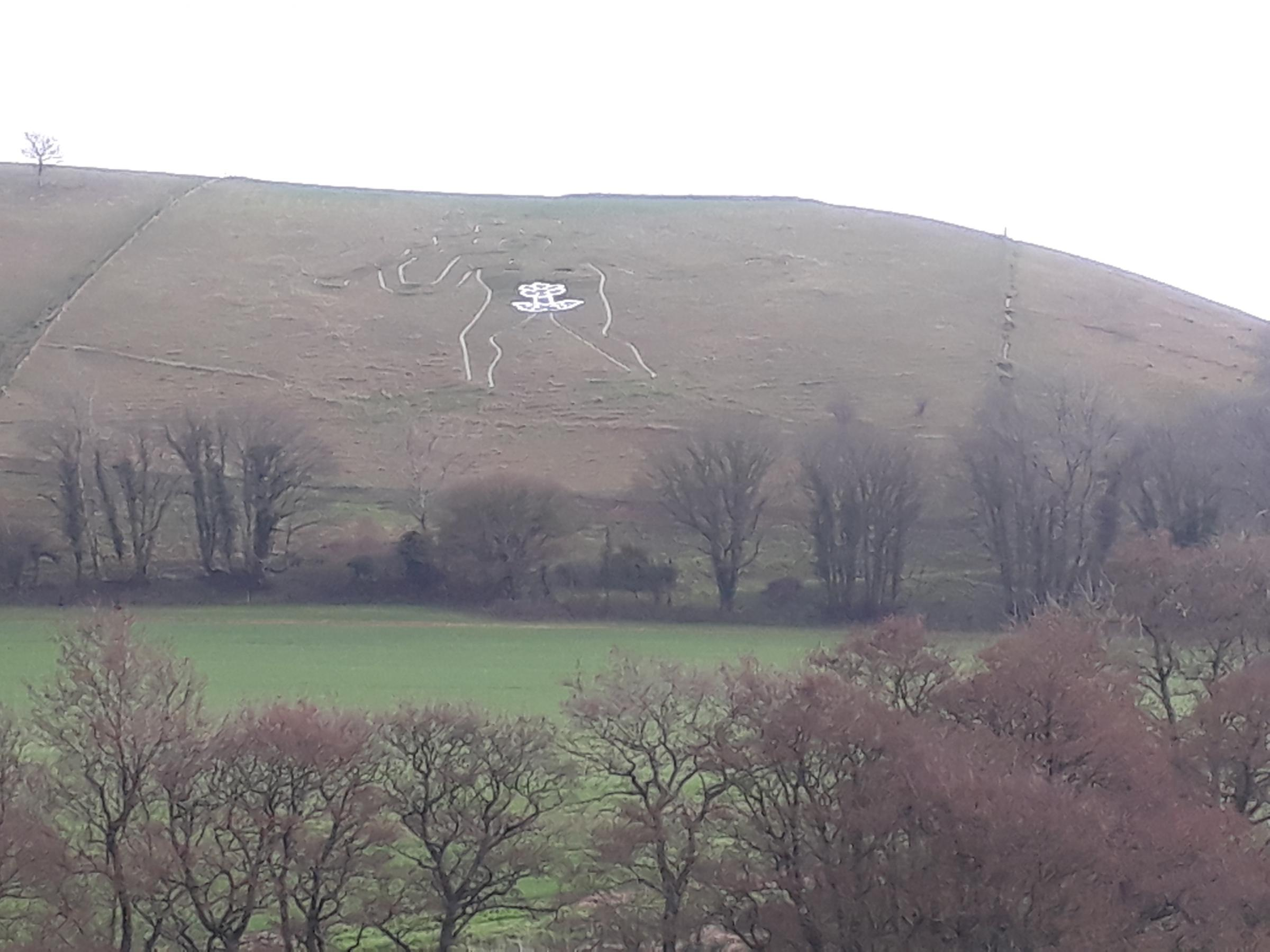 Cerne Giant wears a flower for International Womens' Day
