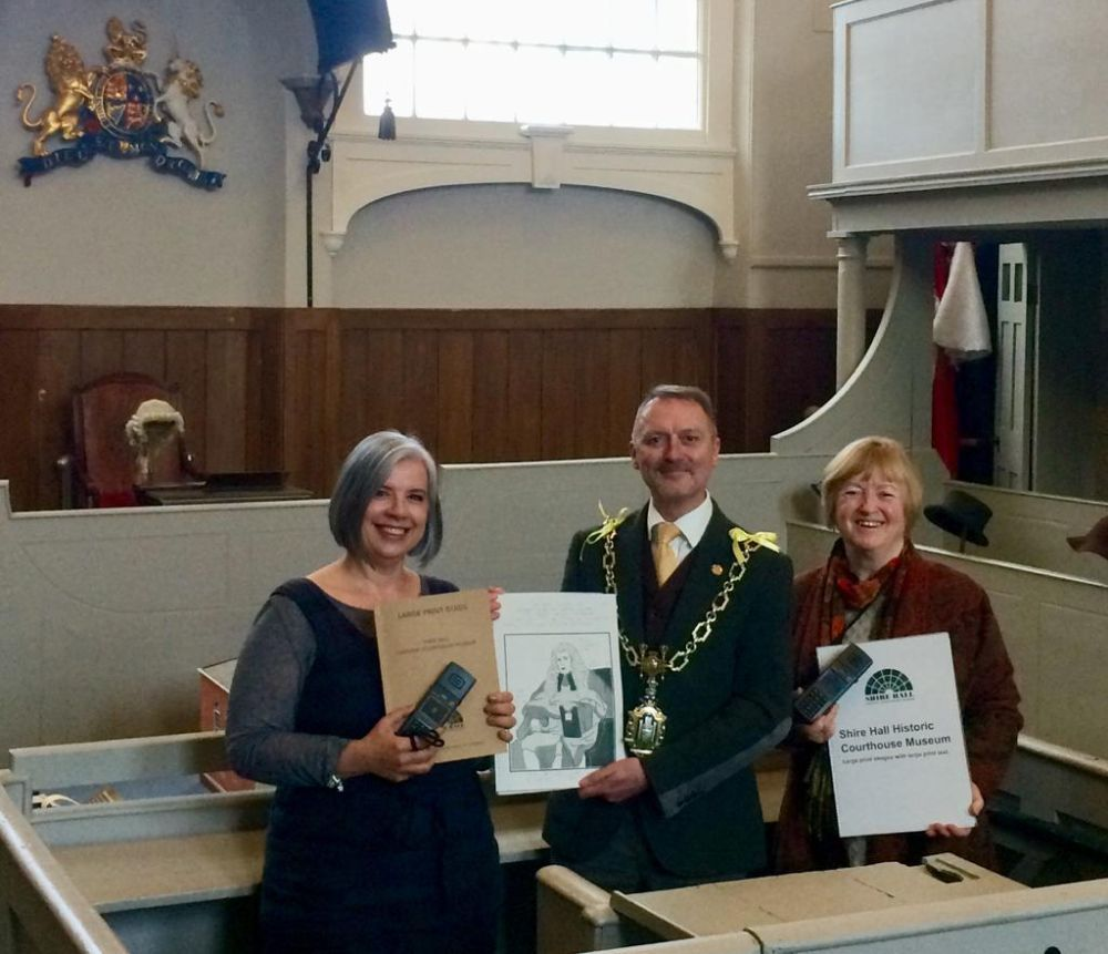 New accessibility guides for visitors to Shire Hall Historic Courthouse Museum. L-R: Shire Hall Director Anna Bright with current Mayor of Dorchester David Taylor and former Mayor Susie Hosford.