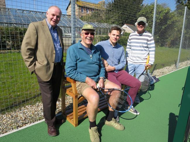 Thomas Hardye student George Howell with Dorchester town clerk Adrian Stuart (left) and tennis players Mike Davis and David Moth, a guitar maker, who described the bench as 'a fine piece of work.'