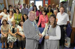 FOND FAREWELL: Clive Burgess pictured with Pam Govier and staff from Wey Valley School