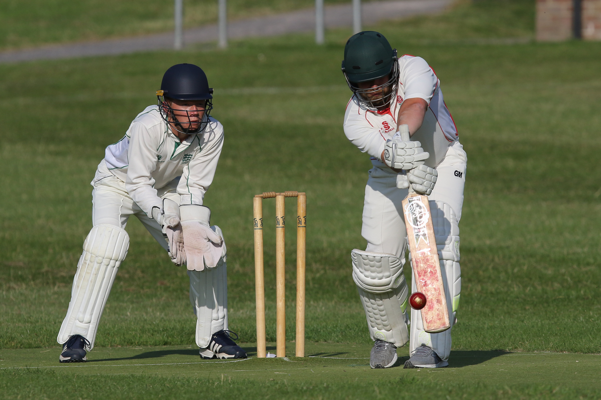BIG WIN: Matt King, right, helped St George's to victory over Bere Regis Picture: PHIL STANDFIELD