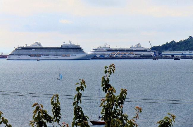 AIDAaura and Seven Seas Explorer cruise ships at Portland Port  Picture: Lesley Maxwell
